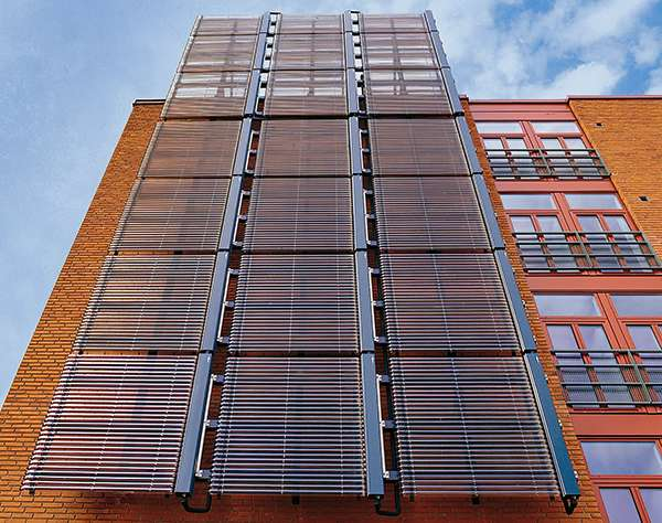 Инсталиране на вакуумни колектори на фасада на здание